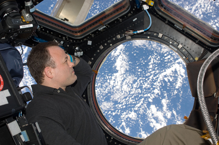 Ron Garan looking out the ISS windows